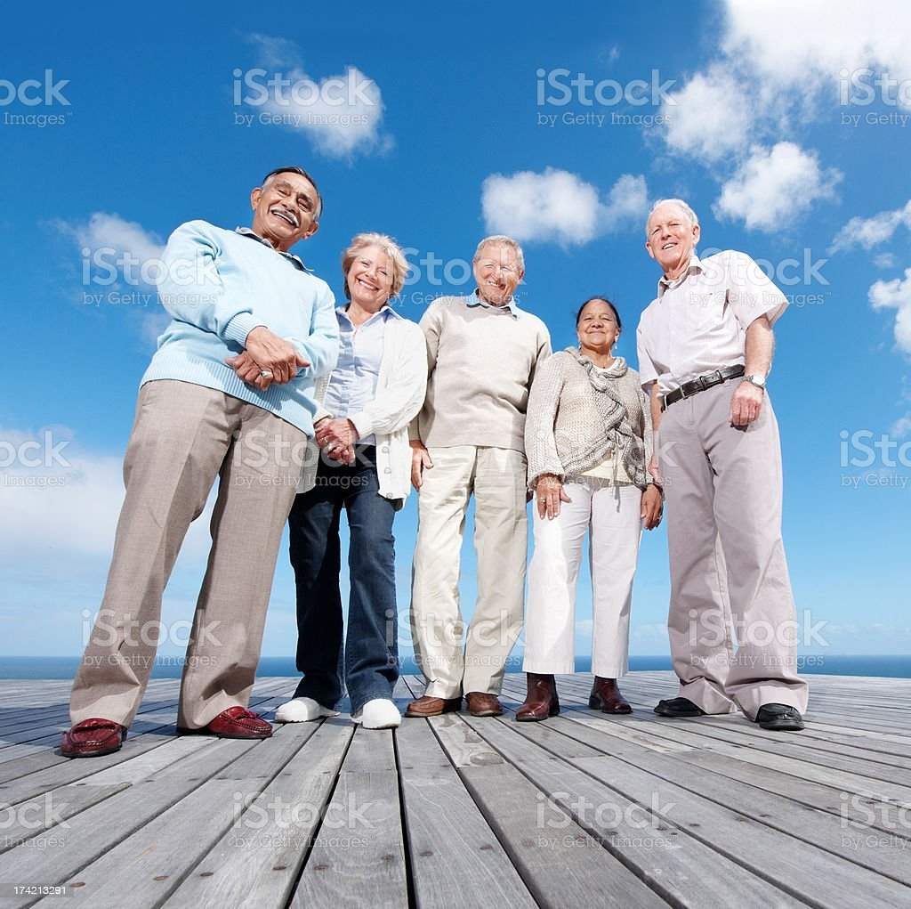Group of mature friends enjoying their holiday stock photo