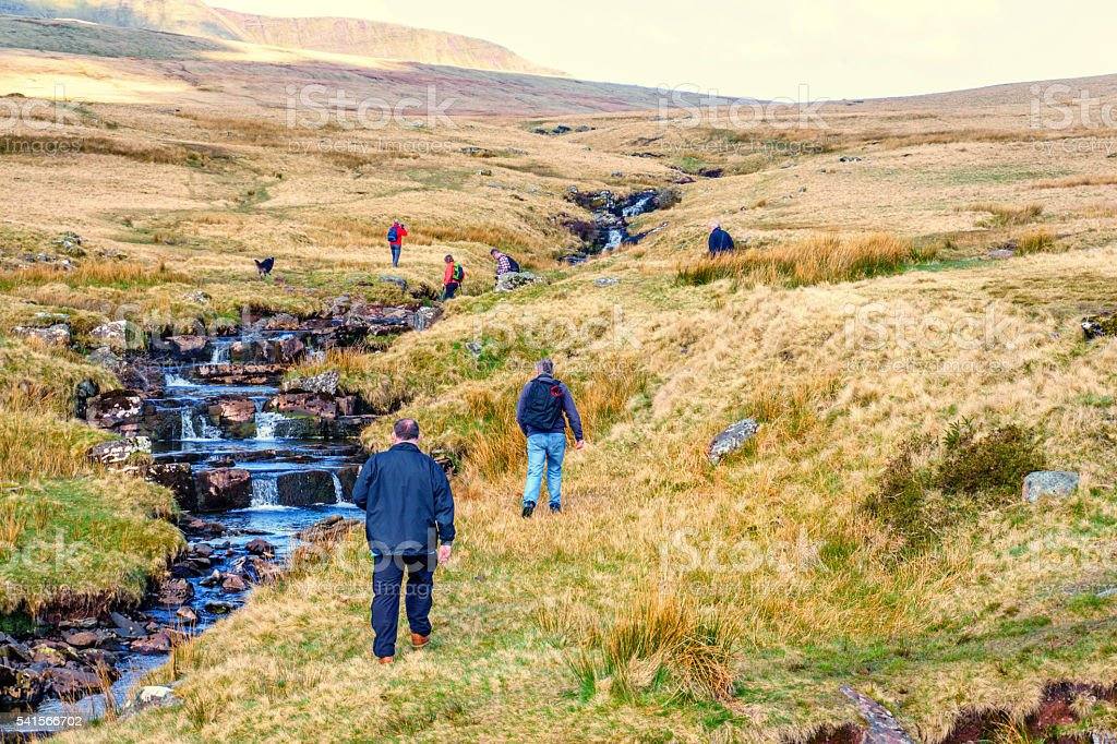 Group of mature people hiking in Welsh countryside stock photo