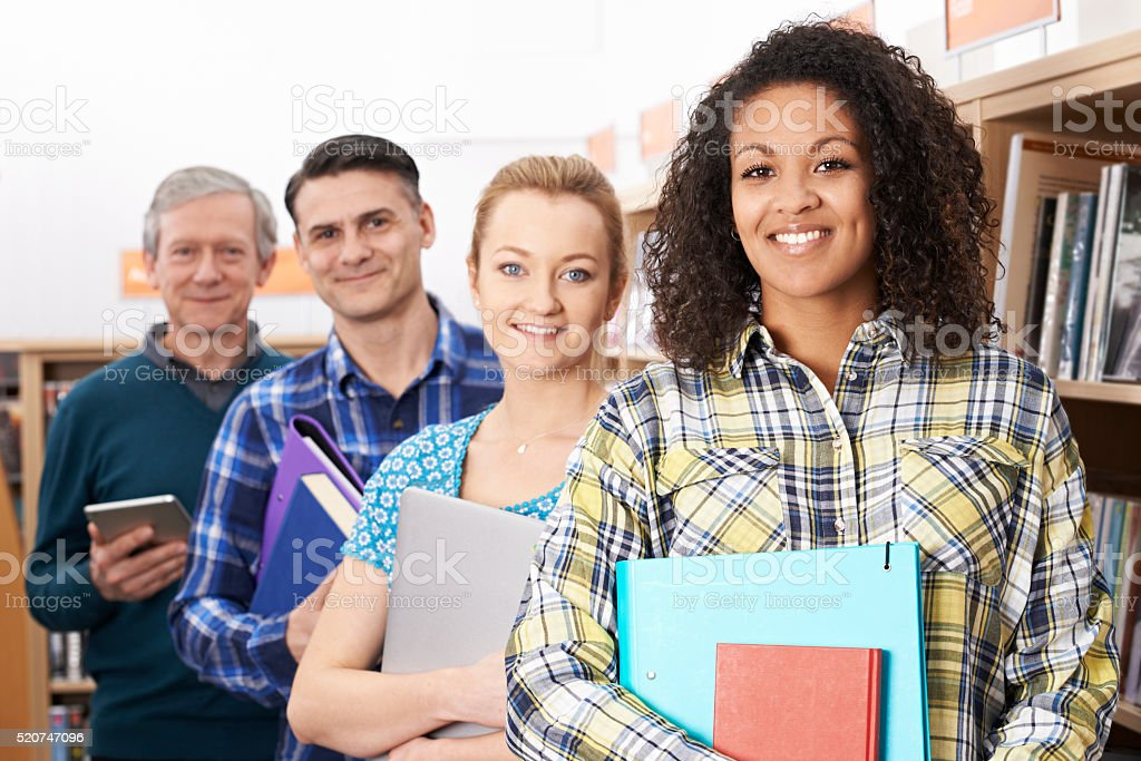 Group Of Mature Students Studying In Library stock photo