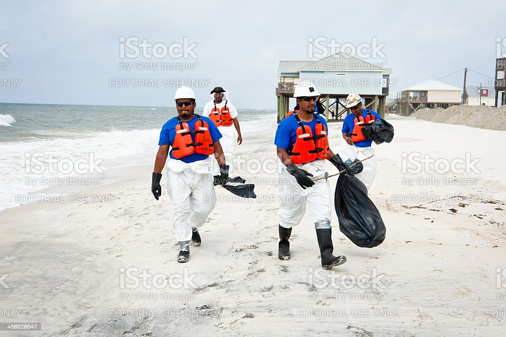 Group of men cleaning up after the BP oil spill stock photo