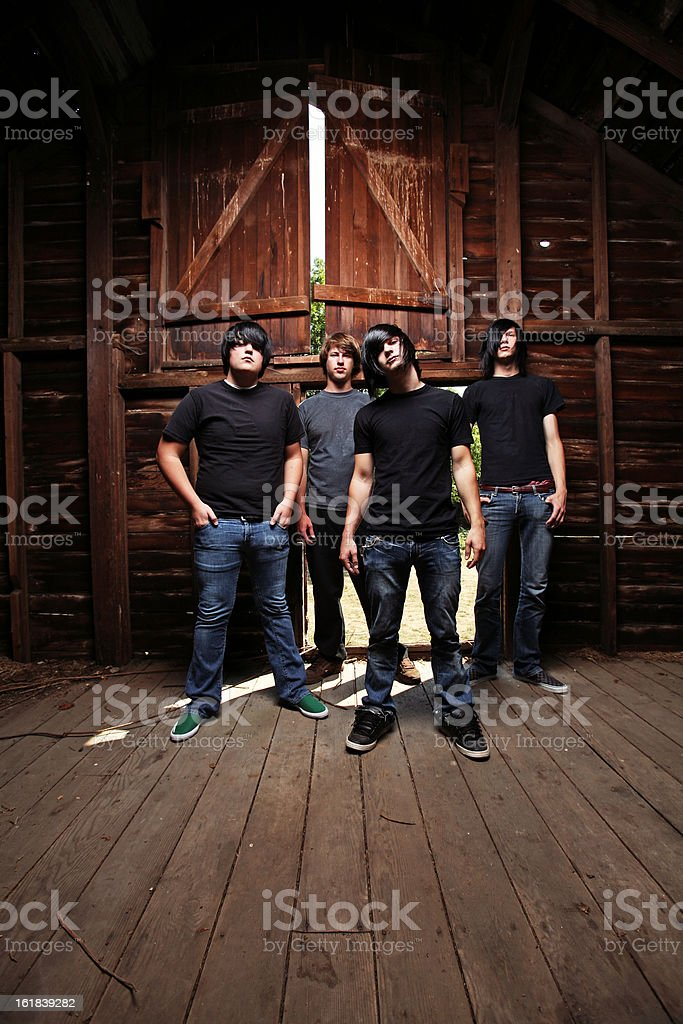Group of Men Dressed in Black Standing stock photo