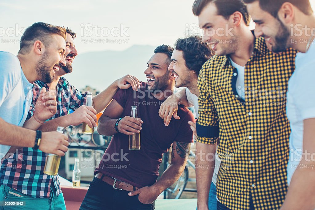 Group of men drinking beer stock photo
