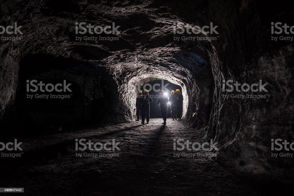 Group of men in a mine stock photo