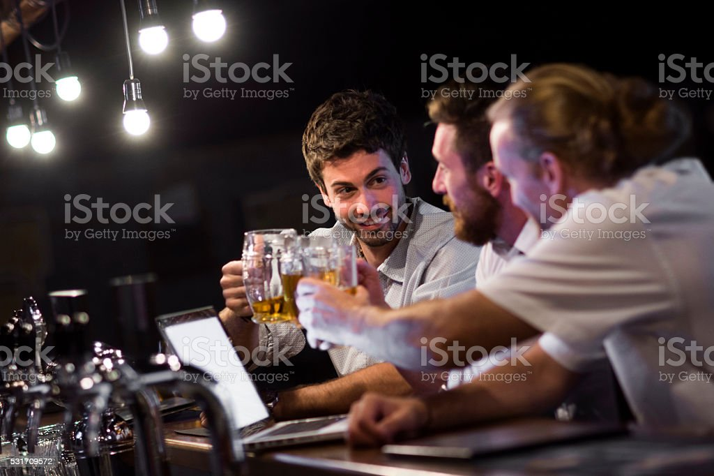 Group of men making a tost stock photo