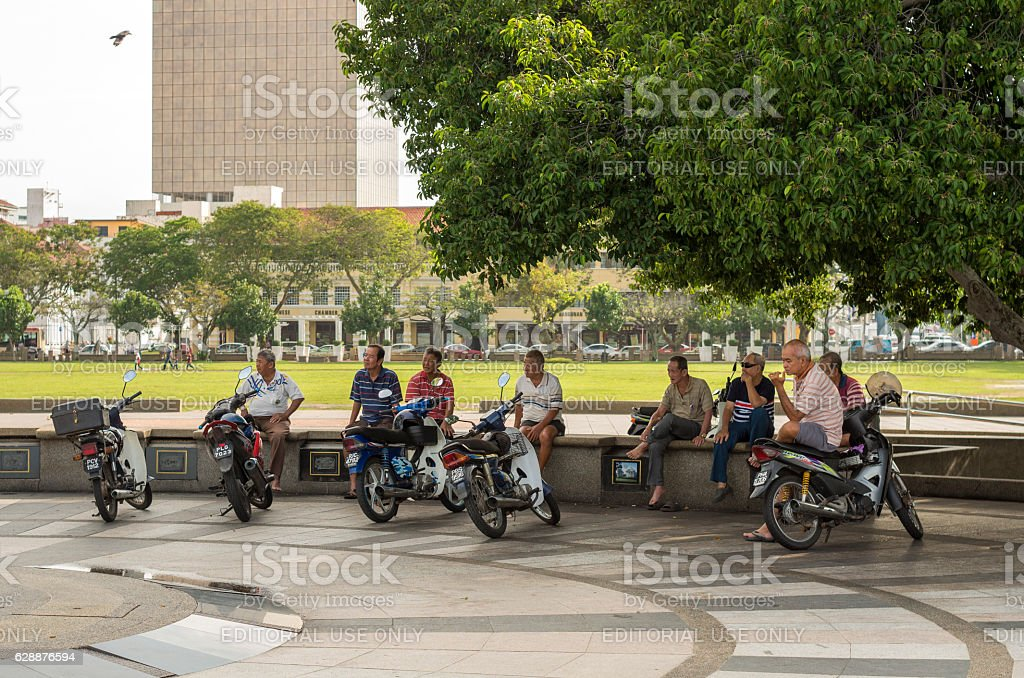 Group of men on the street stock photo