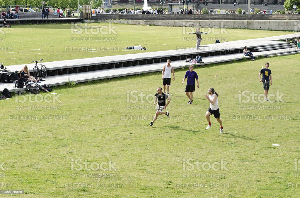 Group of men playing Ultimate Frisbee in Berlin royalty-free stock photo