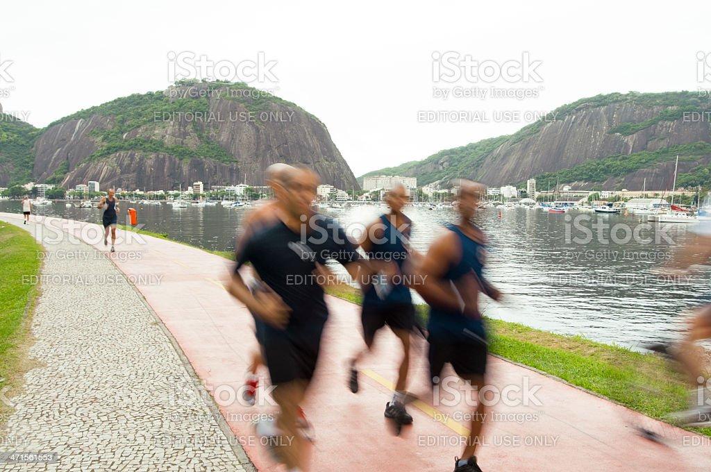 Group of Men Running, Botafoga, Rio de Janerio, Brazil. royalty-free stock photo