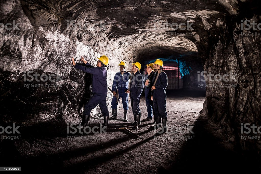 Group of men working at a mine stock photo