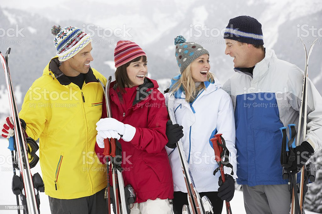 Group Of Middle Aged Couples On Ski Holiday In Mountains stock photo