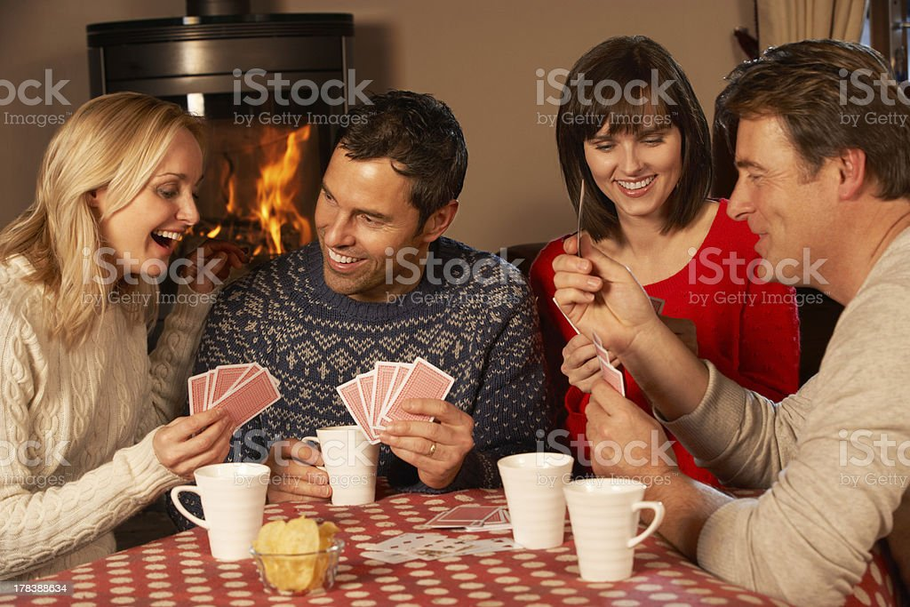 Group Of Middle Aged Couples Playing Cards Together royalty-free stock photo