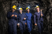 Group of miners mining underground