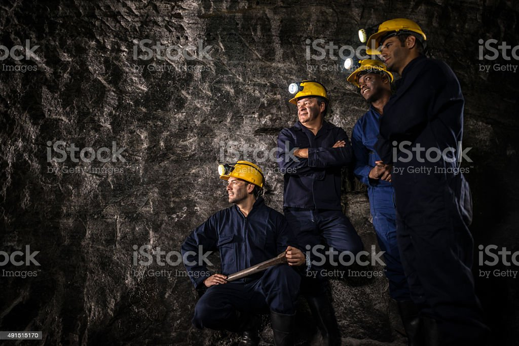Group of miners on a break stock photo