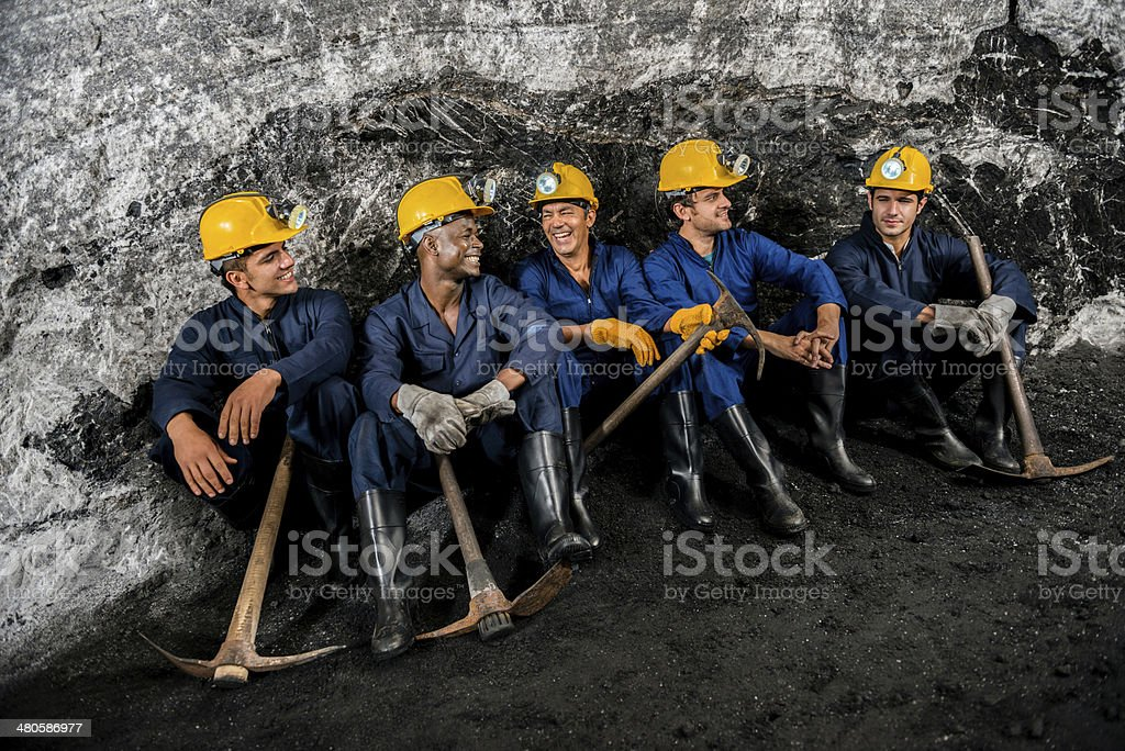 Group of miners taking a break royalty-free stock photo