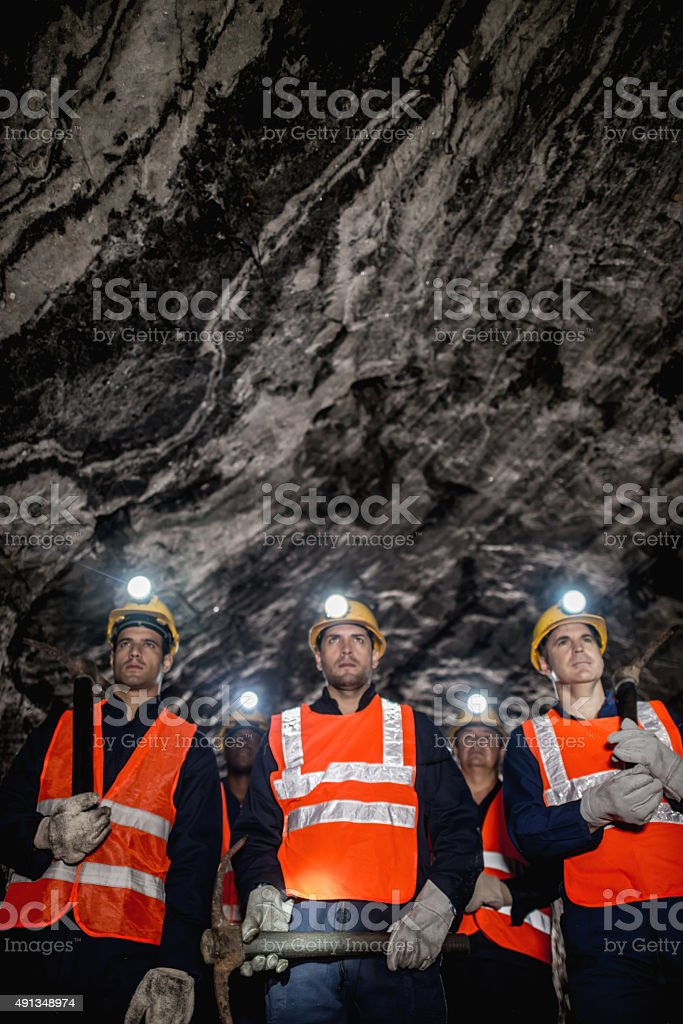 Group of miners working at the mine stock photo
