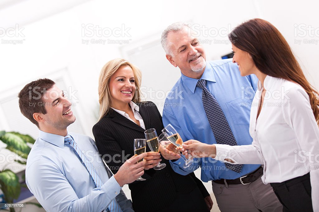 Group of mixed age business people having celebrity toast. stock photo