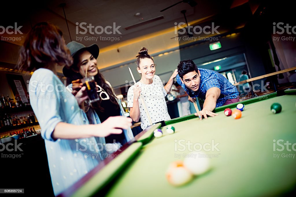 Group of mixed race friends in pub stock photo