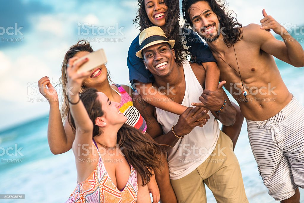 Group of mixed race friends take a selfie in miami stock photo