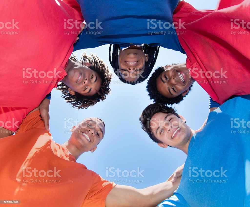 Group of mixed race male young adults in a circle stock photo