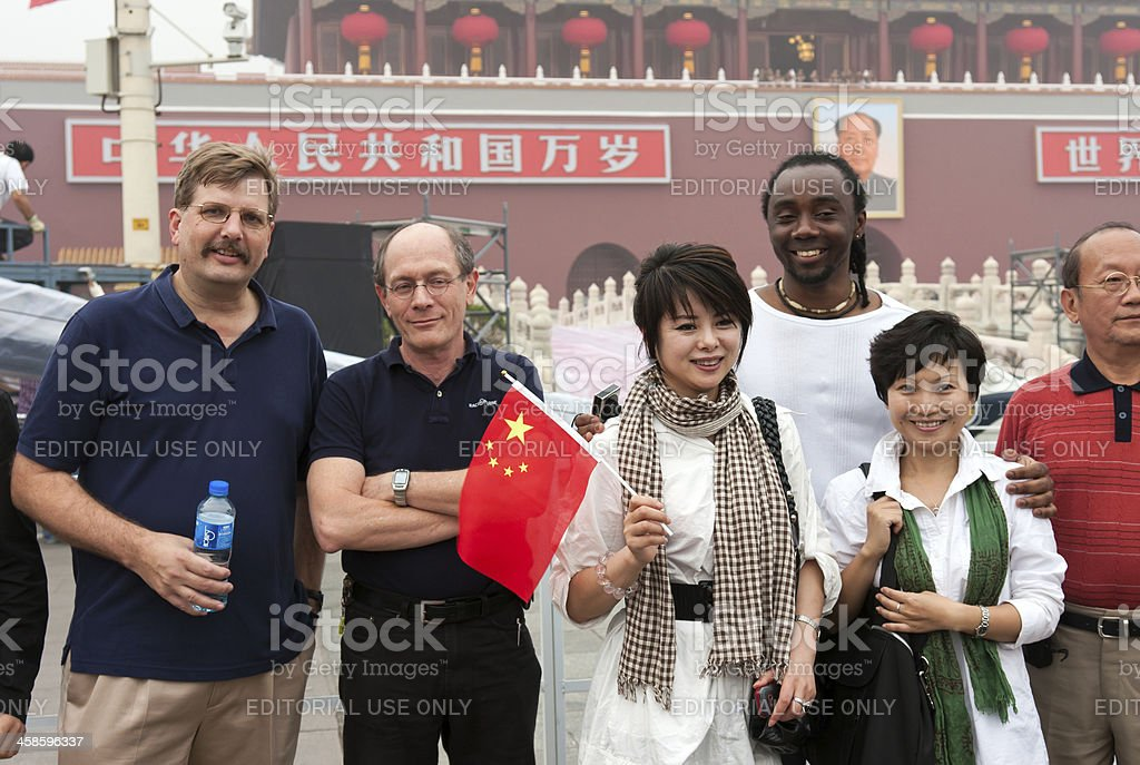 Group of mixed race people take pictures in Tiananmen Square royalty-free stock photo