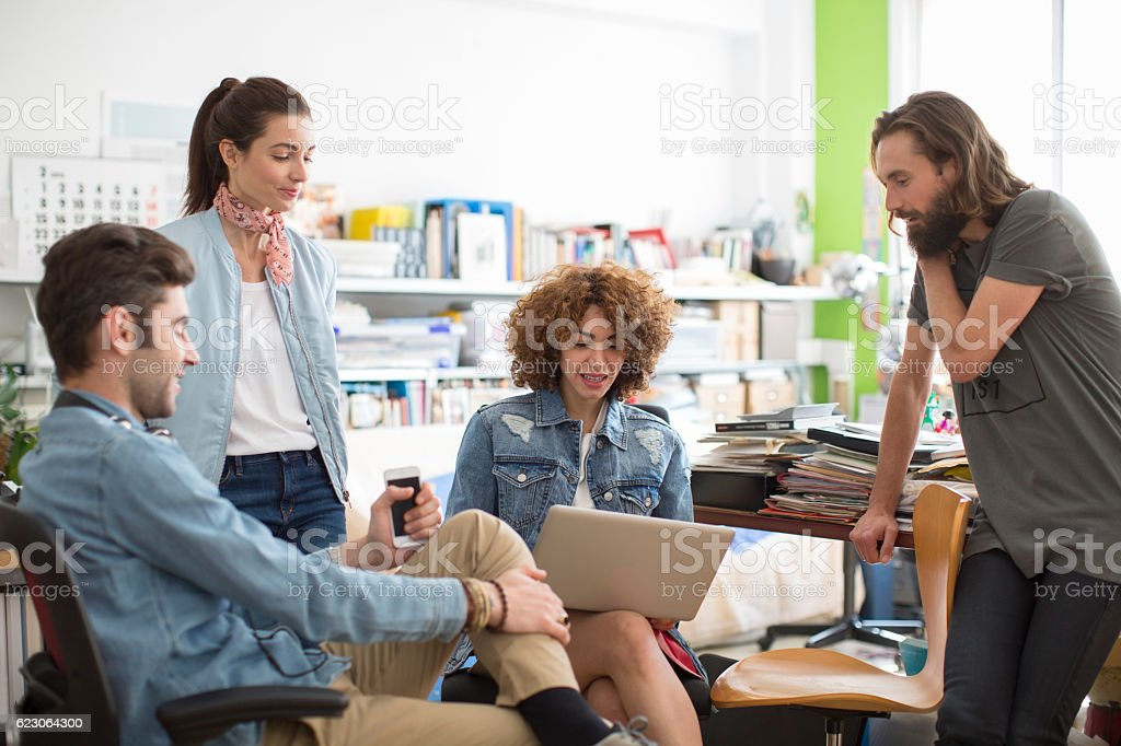 Group of modern and trendy people working on startup stock photo
