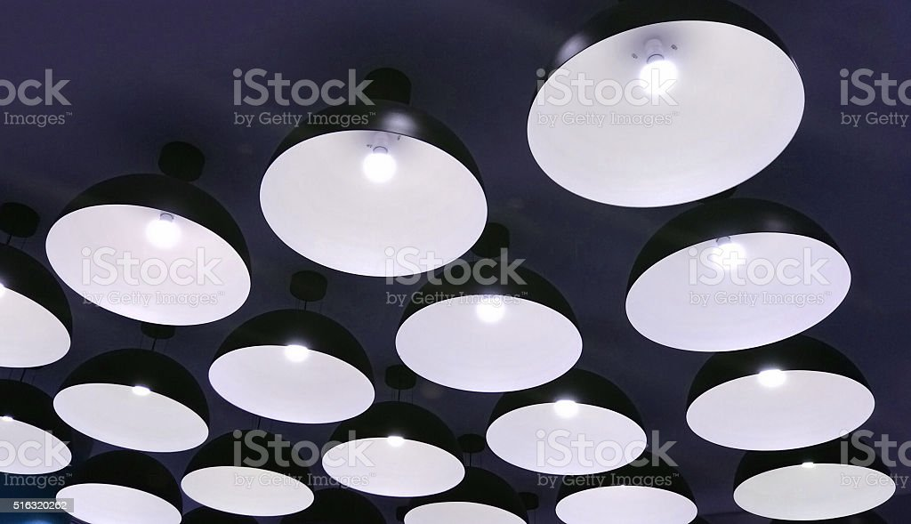 Group of Modern Black Metal Illuminated Lamps Hanging stock photo