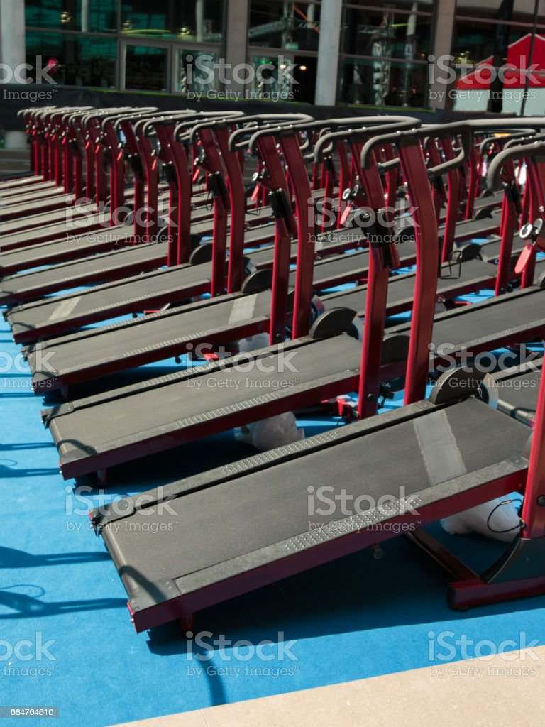 Group of Modern Treadmill in Line in Fitness Center stock photo