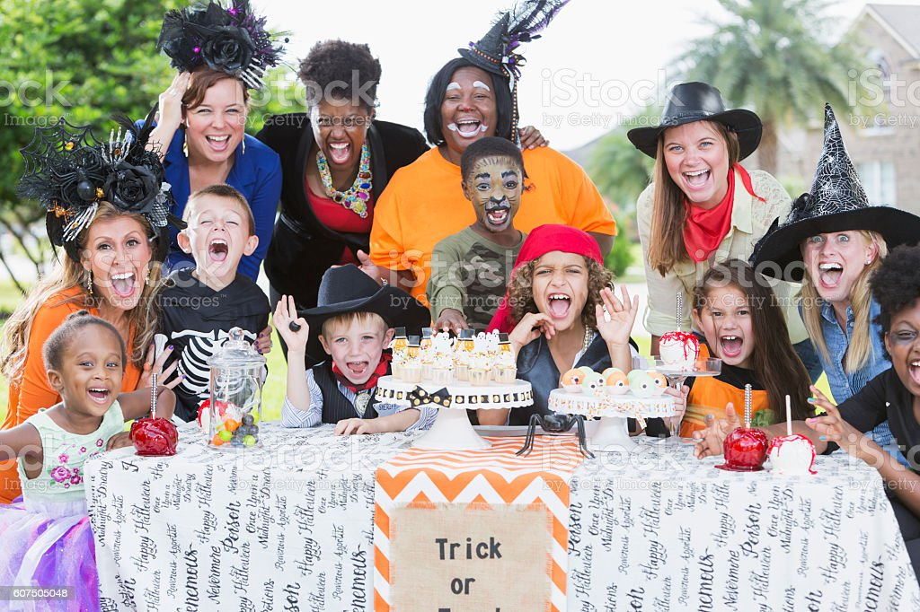 Group of mothers and children at Halloween party stock photo