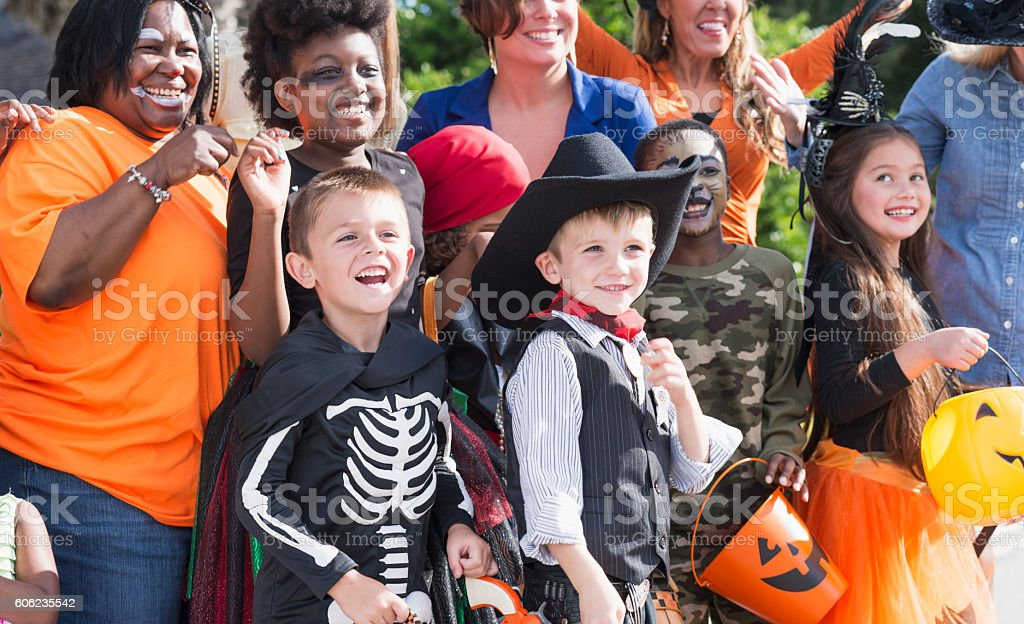 Group of mothers and children at Halloween stock photo