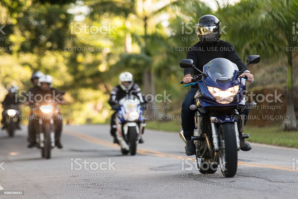 Group of motorcyclists on the road to motorcycle festival stock photo