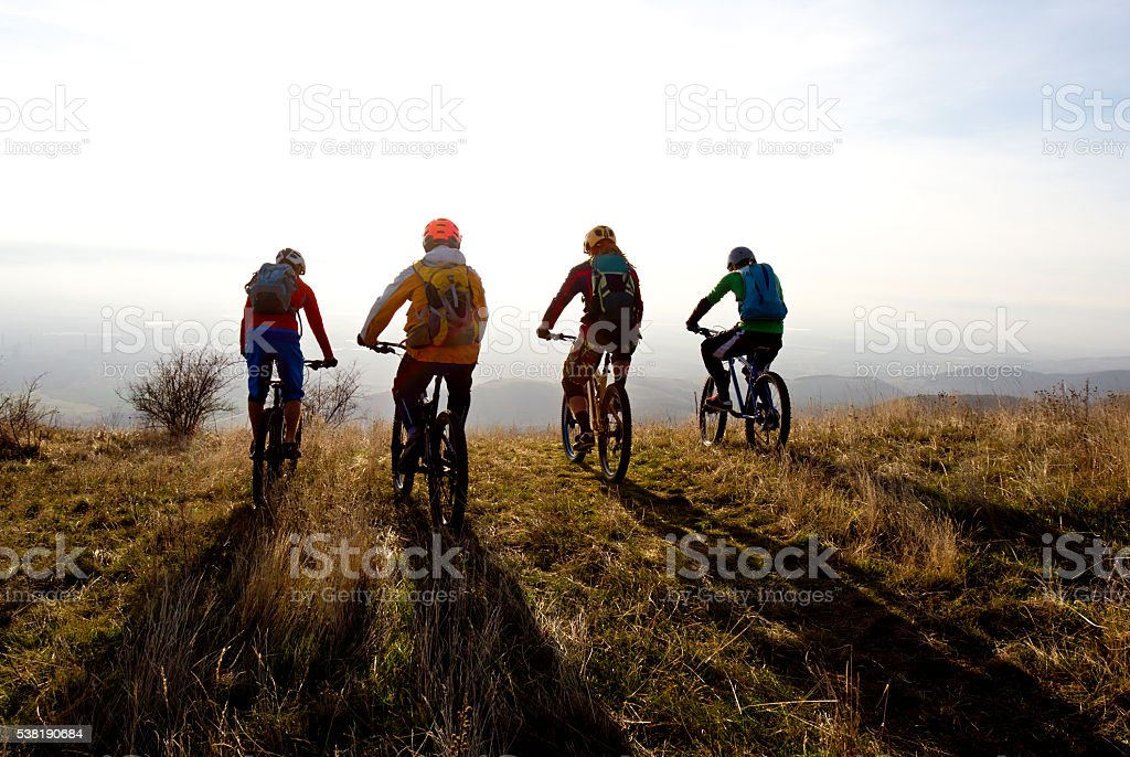 Group of mountain bikers ready for a ride stock photo