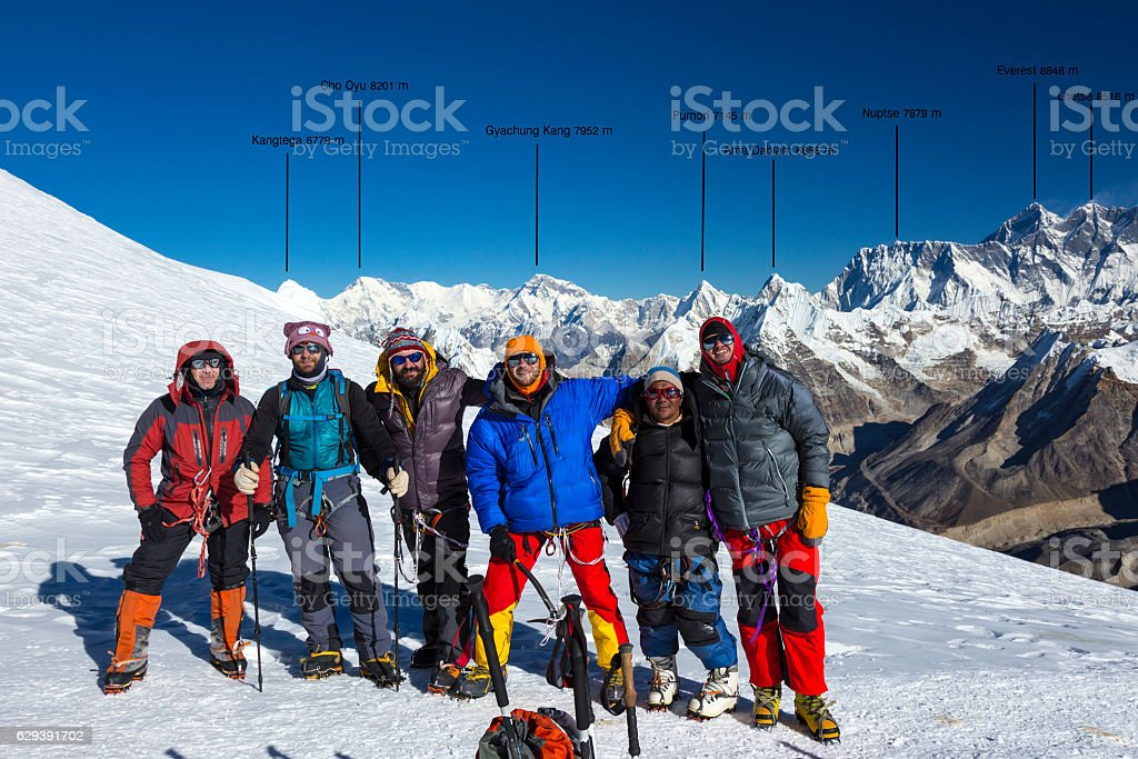 Group of Mountain Climbers on High Altitude Mountain of Himalaya stock photo