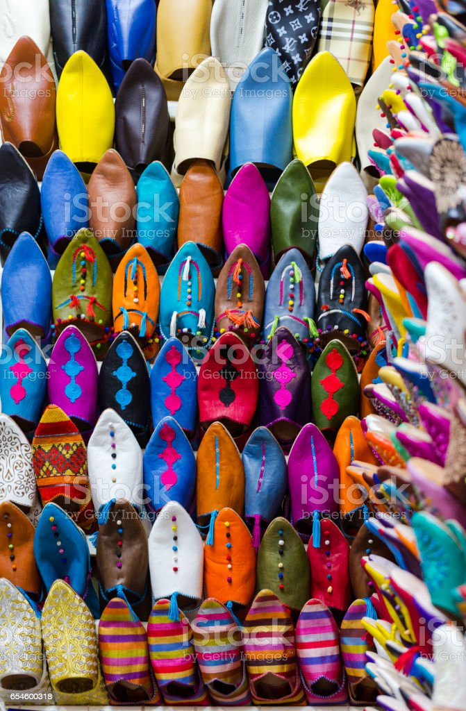 Group of multi colour slippers for sale on market stock photo