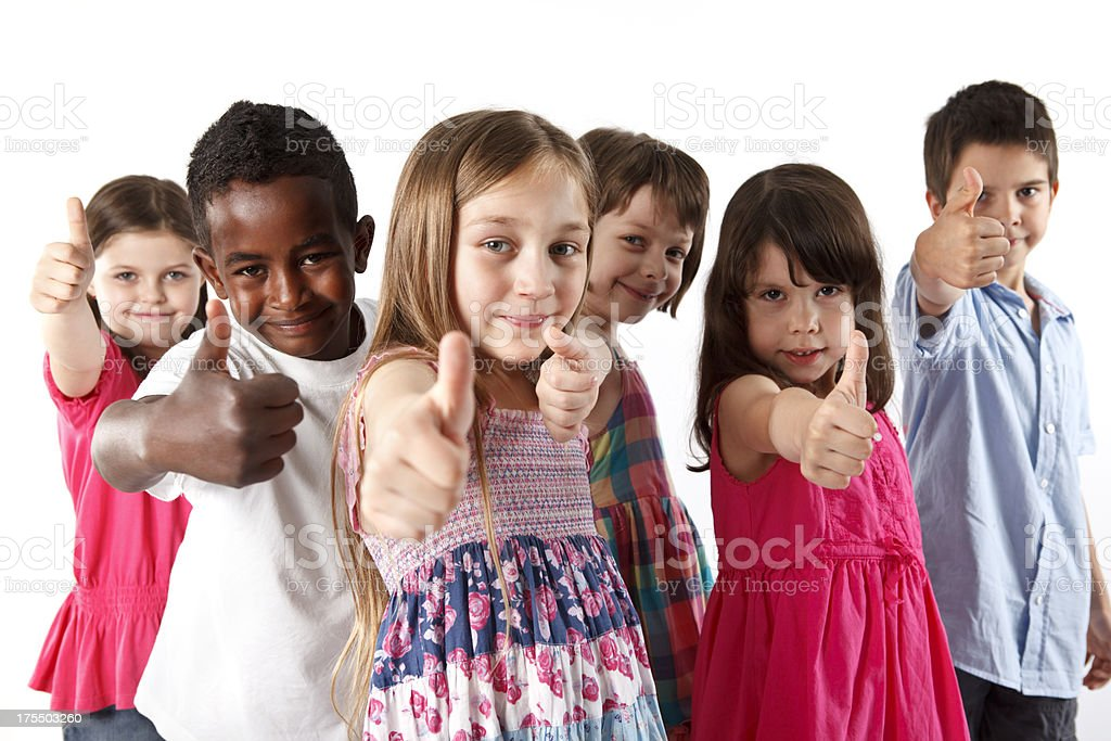 Group of multi ethnic children showing thumbs-up royalty-free stock photo