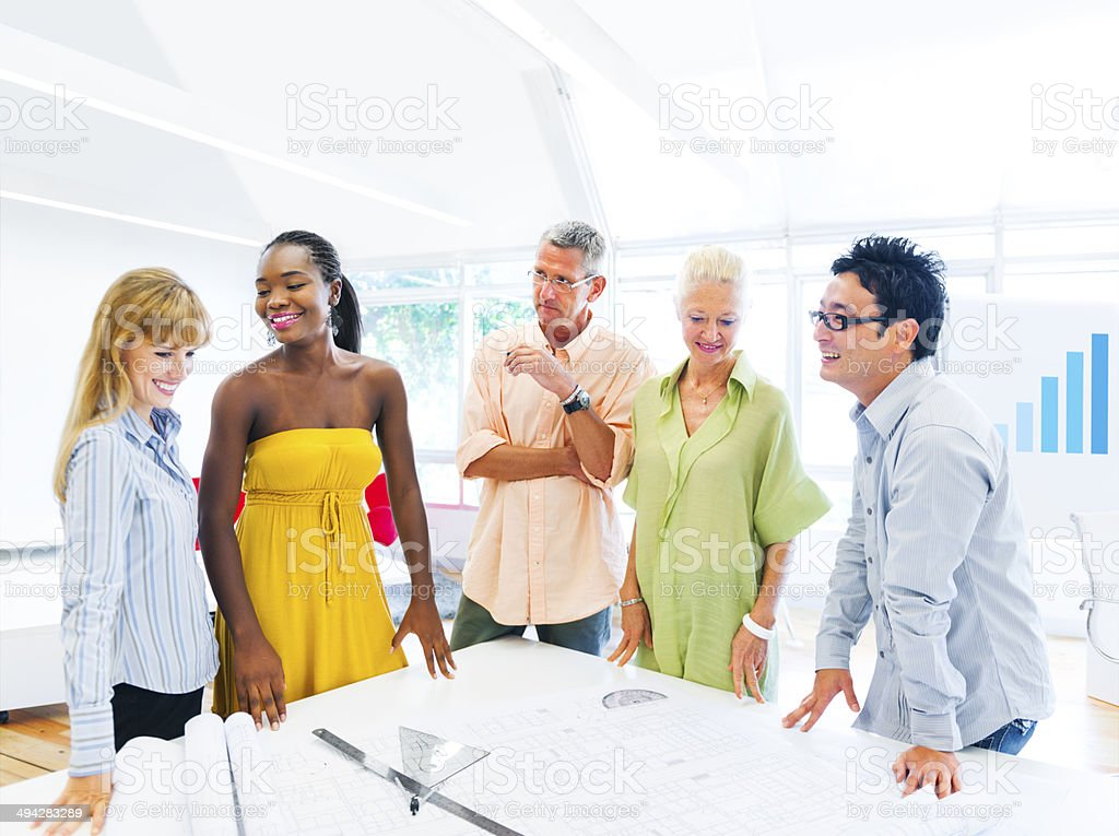 Group of Multi Ethnic Designers Having a Meeting stock photo