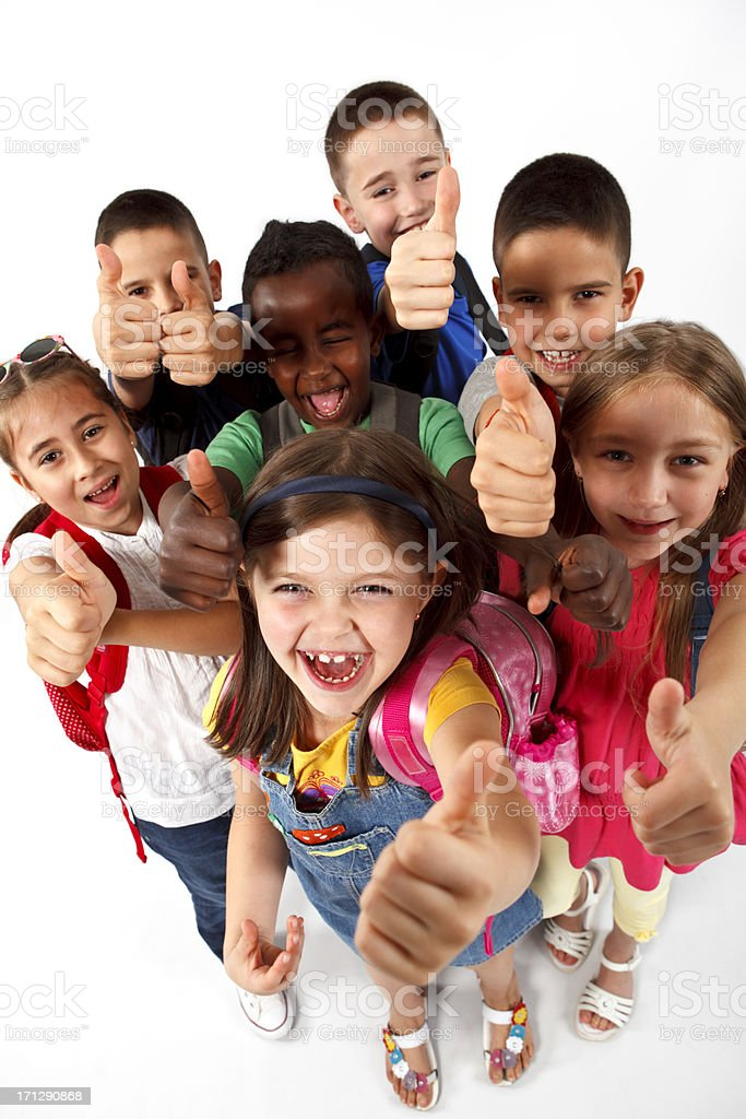 Group of multi ethnic school children shouting and showing thumbs-up royalty-free stock photo