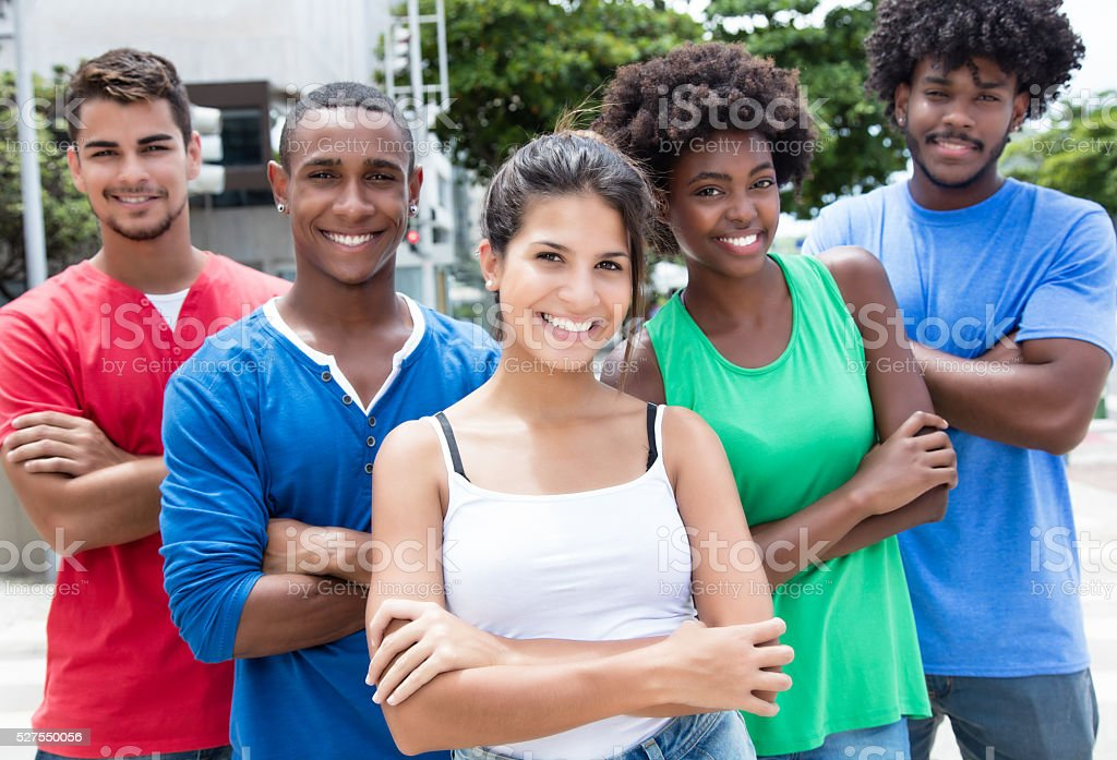 Group of multi ethnic young adults with crossed arms stock photo