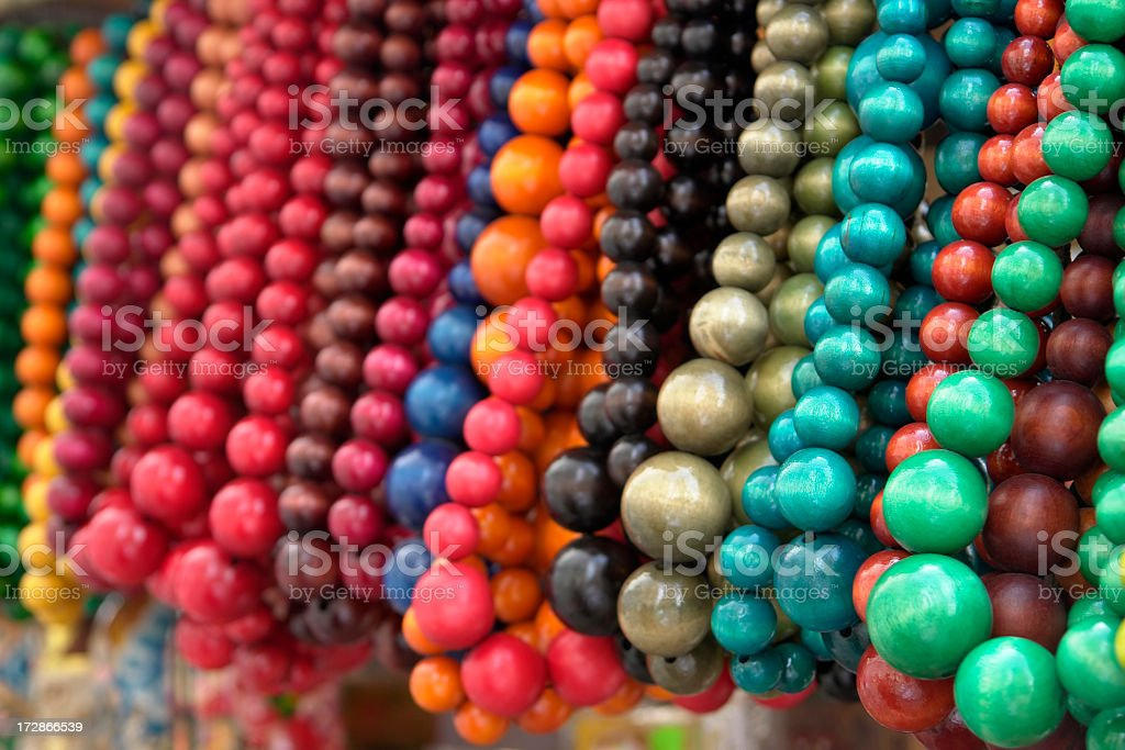 Group of multicoloured beads hanging on the street stock photo