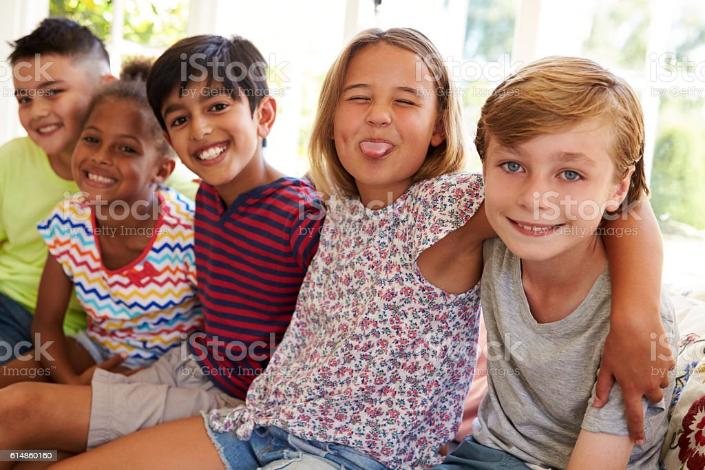 Group Of Multi-Cultural Children On Window Seat Together stock photo