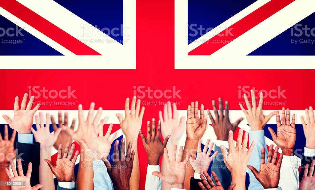 Group of Multi-Ethnic Arms Raised with Flag of United Kingdom stock photo
