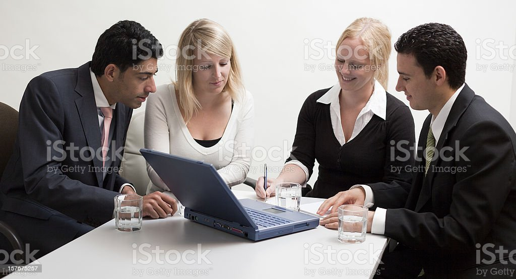 Group of multi-ethnic business people in teamwork with laptop presentation royalty-free stock photo