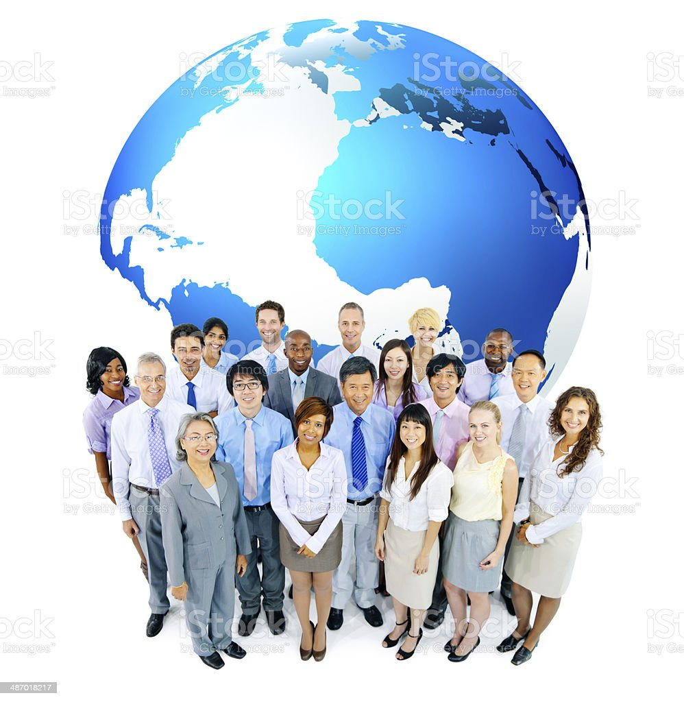 Group Of Multi-Ethnic Business People Standing In Front Of A Globe stock photo