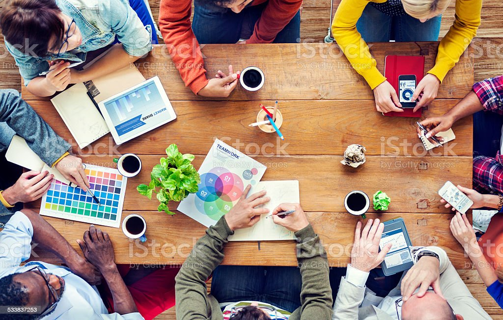 Group of Multiethnic Designers Brainstorming stock photo