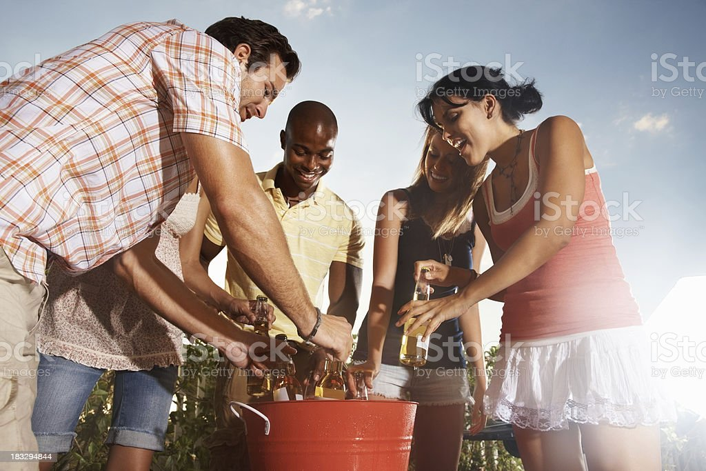 Group of multi-ethnic friends having beer on a vacation stock photo