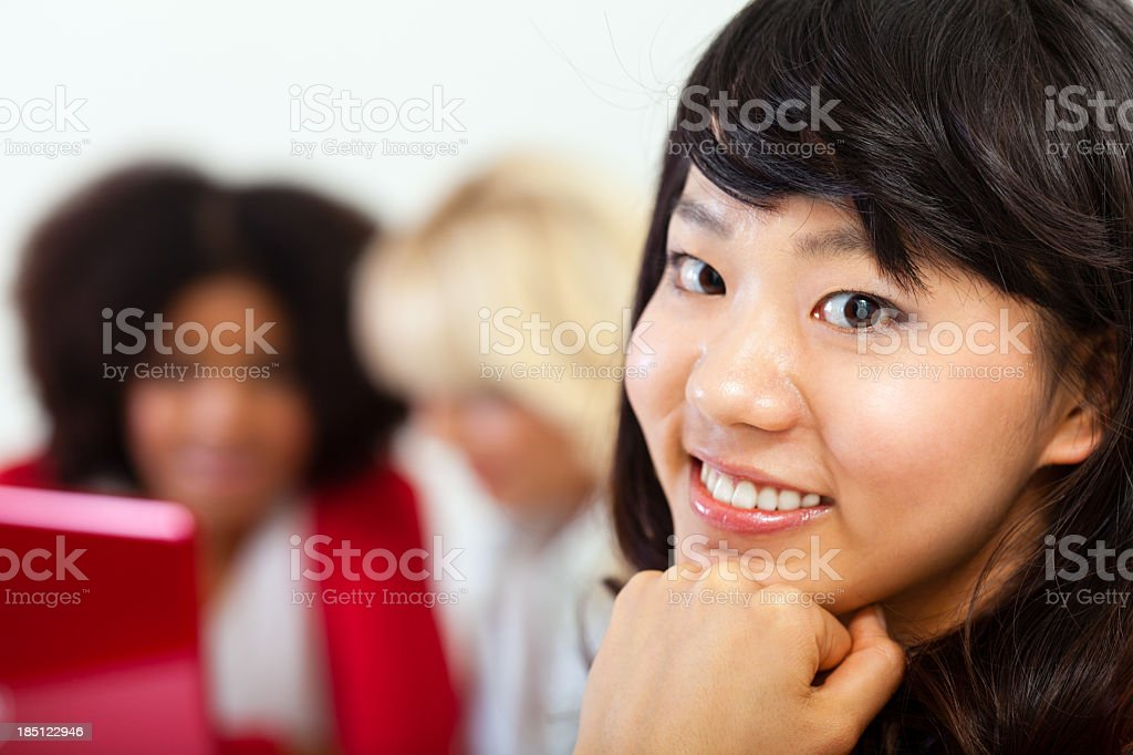 Group of multi-ethnic friends working on laptop royalty-free stock photo