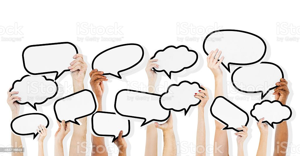 Group Of Multi-Ethnic People Holding Empty Speech Bubble stock photo