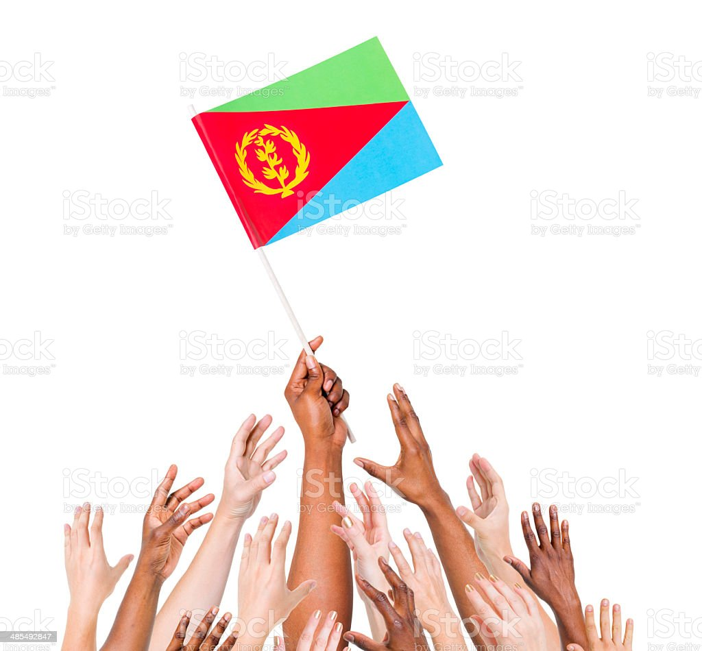Group of Multi-Ethnic People Reaching the Flag of Eritrea stock photo