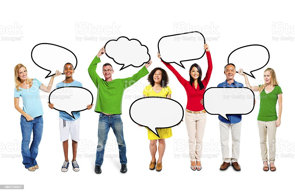 Group of Multiethnic People Standing with Blank Speech Bubbles stock photo