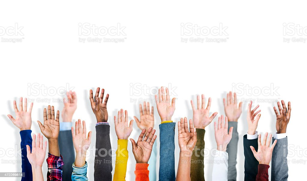 Group Of Multi-Ethnic People's Arms Outstretched In A White Back stock photo