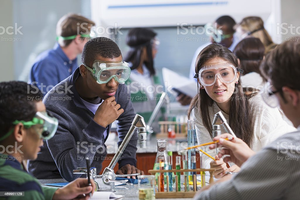 Group of multi-ethnic students in chemistry lab stock photo