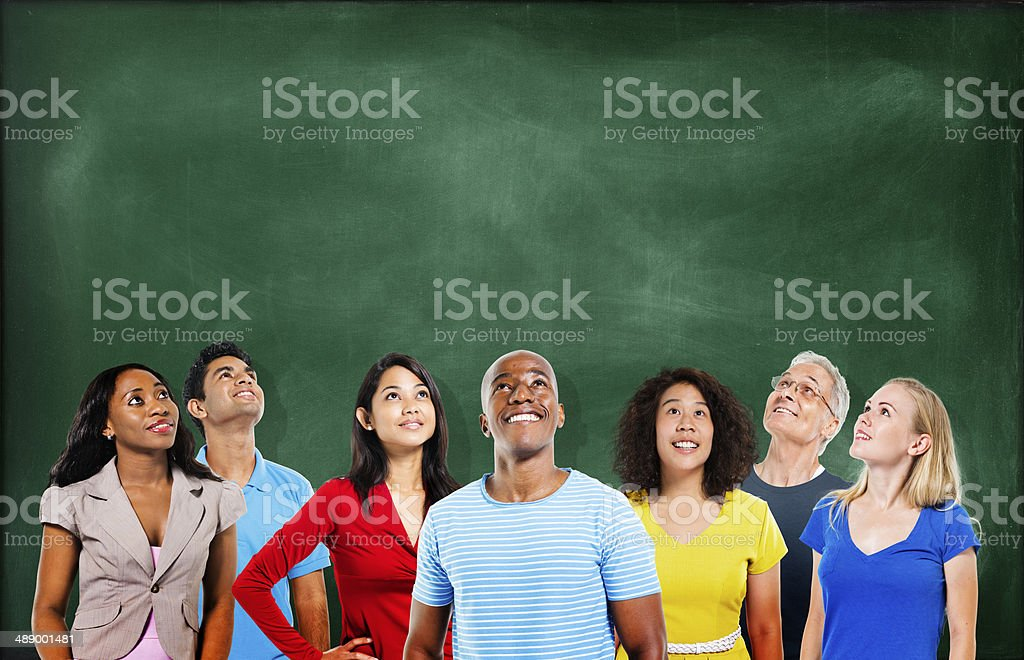 Group of Multiethnic Students Looking Up with Blackboard stock photo